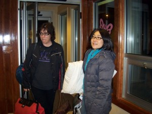 Weary travelers, Diane and Juni, arrive at the hotel.