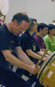 students learning taiko