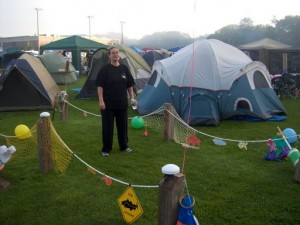 "Joy strolls through the ""In Cod We Trust"" team's campsite."