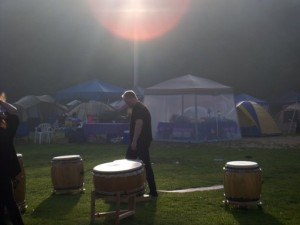 Dave sets drums as the sun crests the tree-tops.