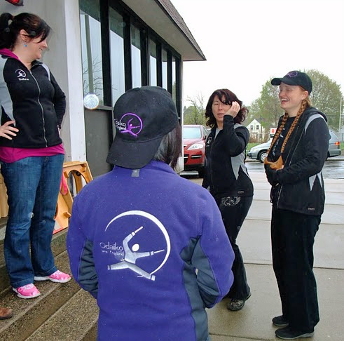 Sheilarae, Kristen, Jasmine, and I sported our new jackets while loading for the first of many spring gigs.